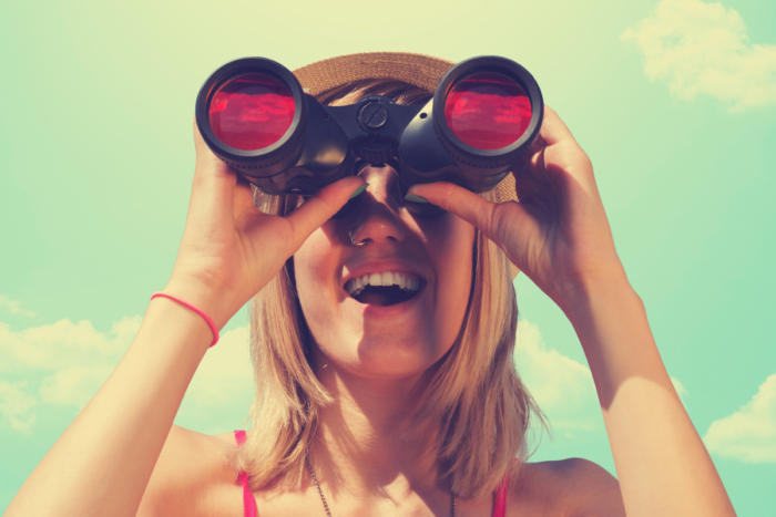 women-looking-through-binoculars_future_vision_prediction_millennial-100745663-large