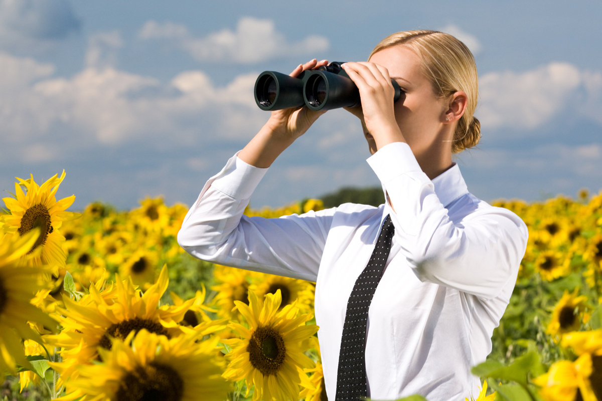 businesswoman-with-binoculars-in-sunflower-field_vision_future_predictions-100745563-large